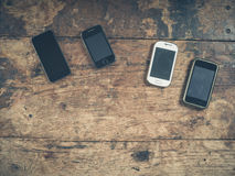 Selection of smart phones on wooden table Stock Photo