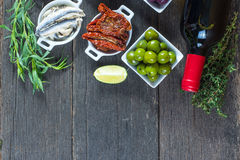 Selection of spanish tapas with red wine from above Royalty Free Stock Images