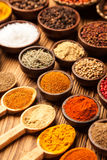 A selection of spices in bowls stock photography