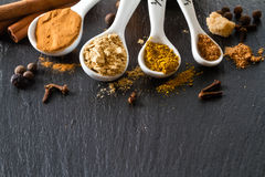 Selection of spices for christmas and thanksgiving. Dark stone background Royalty Free Stock Images