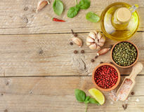 Selection of spices and herbs - garlic, salt, pink, green and black pepper, lemon, Basil, olive oil. Ingredients for cooking. Stock Image