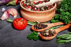 Herbs and spices over black stone background. Top view with copy space. royalty free stock photos