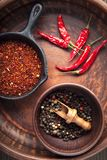Selection of spices pepper. Food background on black wood table. Top view Royalty Free Stock Photography