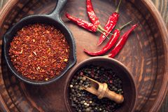 Selection of spices pepper. Food background on black wood table. Top view Stock Photography