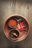 Selection of spices pepper. Food background on black wood table. Top view copy space Royalty Free Stock Images