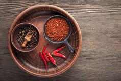 Selection of spices pepper. Food background on black wood table. Top view copy space Royalty Free Stock Photography