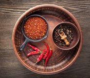 Selection of spices pepper. Food background on black wood table. royalty free stock photos