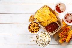 Selection of stadium game foods - nachos, pop corn, pretzels, corn dogs