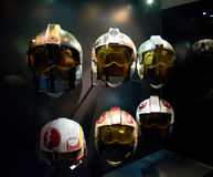 Selection of Star Wars pilot helmets. Six pilot helmets, used in Star Wars films. Exhibited at Star Wars Identities, O2 arena, Greenwich peninsula, London Stock Image