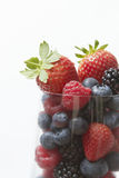 Selection Of Summer Fruits In Glass Against White Background Stock Image