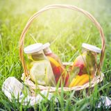 Selection of summer lemonades. Basket on the meadow with refresh stock photos