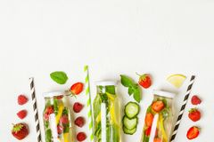 Selection of summer lemonades and ingredients. Lemon, berries and mint stock images