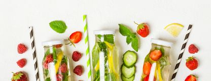 Selection of summer lemonades and ingredients. Lemon, berries and mint royalty free stock photos