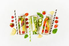 Selection of summer lemonades and ingredients. Lemon, berries and mint royalty free stock photography