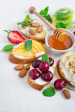 selection summer sweet snacks. Bruschetta or sandwiches with fruit and berries. Selective focus royalty free stock photo