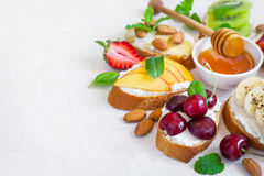 selection summer sweet snacks. Bruschetta or sandwiches with fruit and berries. Selective focus, copy space stock images