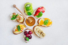 selection summer sweet snacks. Bruschetta or sandwiches with fruit and berries. Top view with copy space royalty free stock photography