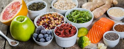 Selection of superfoods on rustic background. Copy space Stock Image