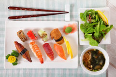 Selection of sushi plate with chopsticks on mat Royalty Free Stock Photography