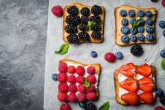 Selection of toasts with cheese peanut butter and berries Stock Photography