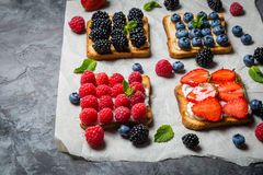 Selection of toasts with cheese peanut butter and berries Stock Image