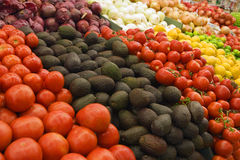 Selection of tomatoes, avocados and red onions on display on market stall (full frame) Stock Photos