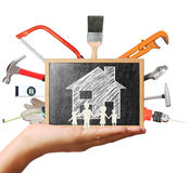 Selection of tools in the shape,home improvement concept. Selection of tools in the shape of a house, home improvement concept Stock Images