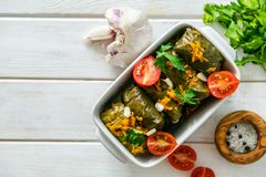 Selection of traditional greek food - salad, meze, pie, fish, tzatziki, dolma on wood background. Top view royalty free stock images