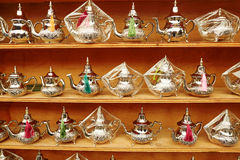 Selection of traditional Moroccan teapots. Selection of traditional teapots on Moroccan market (souk) in Fes, Morocco Stock Images