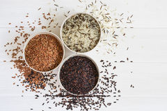 Selection of variety of gourmet rice in bowls. Top view with copy space Royalty Free Stock Photos