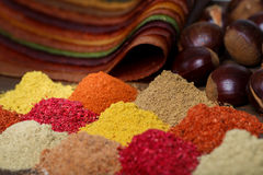 Selection of various colorful spices on a wooden table Stock Photos