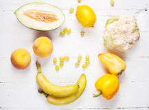 Selection of various fresh yellow raw organic produce fruits and vegetables. Stock Photo