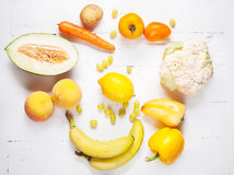 Selection of various fresh yellow raw organic produce fruits and vegetables Stock Images