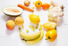Selection of various fresh yellow raw organic produce fruits and vegetables Stock Photos