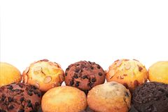 Selection of various muffin cakes lower border white background. Selection of various muffin cakes Stock Photos