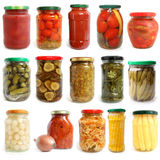 Selection of various vegetables canned in glass jars Stock Photography
