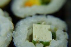 Vegan maki rolls tasting stock image