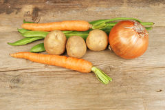 Selection of vegetables on rustic wood Royalty Free Stock Image