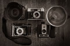 Selection of vintage film cameras with one modern DSLR Royalty Free Stock Photography