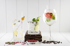 Cocktails drinks beverages background room for text. Selection of well decorated drink cocktail mixed bartender copy space different shapes glass luxury mixology stock image