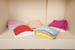 Selection of women clothes on shelf Royalty Free Stock Images