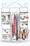 Selection of women`s jewellery hanging on a display rack Royalty Free Stock Image