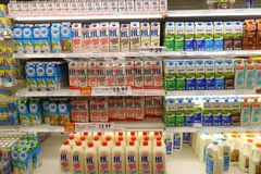 Selection of yogurts soy milk and milk on the shelves. JOHOR BAHRU, MALAYSIA- OCT 29, 2017: Selection of yogurts soy milk and milk on the shelves in a Stock Photography