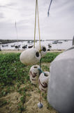 Selective and blurred image of white buoy hanging, anchored boat Royalty Free Stock Images