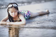 Selective Color Photography of Girl Lying on Beach royalty free stock photography