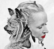 Selective Color Photography of Woman Holding Yorkshire Terrier stock photo