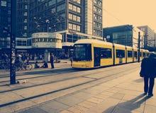 Selective Color Photography of Yellow Train Near Concrete Buildings Stock Photos