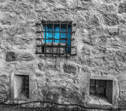 Selective desaturation of a blue window Royalty Free Stock Photography