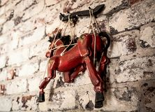 Wooden String Puppet Horse hanging on a wall royalty free stock image