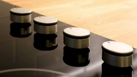 Selective focus on adjustable knobs of kitchen appliance. Selective focus on adjustable knobs of kitchen appliance gas stove on wooden top table background royalty free stock photography